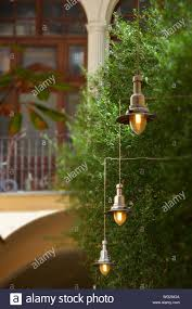 How To Hang Bistro Lights On Stucco String Lights Hanging From Tree In Yard Stock Photo