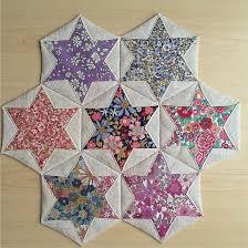 Folded Hexagon Stars   Quilt Blocks and Patterns   Pinterest ... & Folded Hexagon Stars Make a Pretty Table Mat - Quilting Digest Adamdwight.com