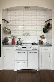 Kitchen Pot Rack Kitchen With White Subway Tile Backsplash And Wall Mounted Pot