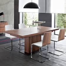 hardware dining table exclusive: the big bollo extending dining table is an innovative and stylish new design the table