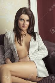 Beautiful Brunette Woman Is Sitting On Sofa With Sexy Open Jacket Stock Photo Picture And Royalty Free Image Image 51893823