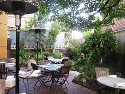 Dining Room:Brightt Outdoor Dining Room Design With Plants Decoration Also  Standing Garden Lamp Plus