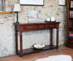 stone hall table. Interior Design Wonderful Stone Wall And Oak Bookshelves Near Classic Wooden Narrow Hallway Table With Small Hall W