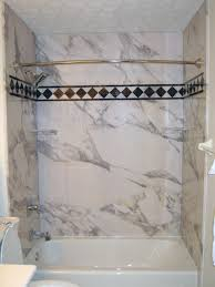 decorative diy interior tub wall panels with an accent strip and corner shelf