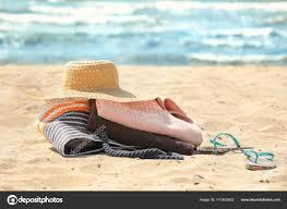 Beach towels on sand Giant Beach Beach Towels Hat And Bag On Sand Photo By Belchonock Walmart Beach Towels Hat And Bag On Sand Stock Photo Belchonock 171453422