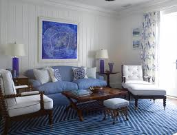 white blue tones living room soft blue club chairs white wooden recliners abstract blue wall paintings