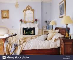 Mirror Bedroom Ornate Gilt Antique Mirror Above Fireplace In Pastel Blue Bedroom