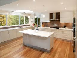 Kitchen:Contemporary And Unique White Countertop Kitchen Design With White  Finished Wooden Cabinets And Island