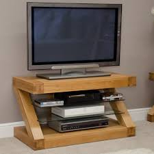Well Turned LED TV Above DVD Player And Books On Glass Layer Fit To Unusual Tv  Stands Plus Simple Carpet And Simple Wall
