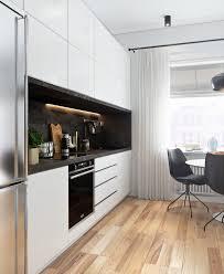Kitchen Television Kitchen Green Wooden Flooring Chandelier Ceiling Grey Sofa