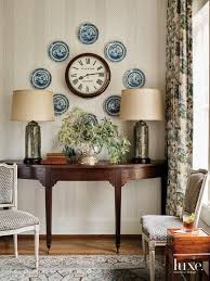 demilune console Theodore Alexander keeping room floral-patterned Jane  Shelton Nina Nash Ed Easterling is hand-glazed lamps by Charlie West Lamps  - The Glam Pad