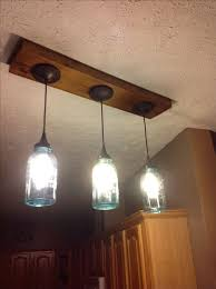 track lighting pendant lights. we replaced our track lighting with blue ball jar pendant lights i had the idea