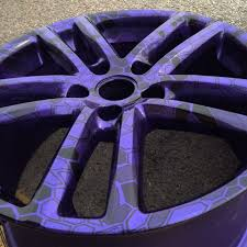 vw toureg alloys hydro dipped in cryptic camo on candy purple base coat by rade customs