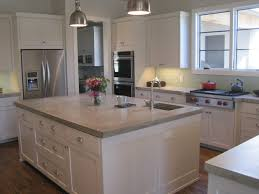 White Island With Concrete Countertop Side By Side Refrigerator ...