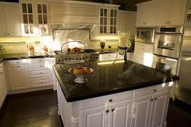 elegant cabinets lighting kitchen. White Kitchen Cabinets With Dark Granite Countertops Cream Countertop Brown Laminated Wooden Island Mocaic Tile Backsplash Elegant Lighting