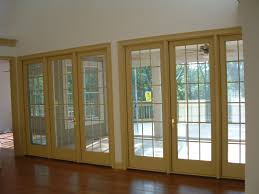 yellow door frame glass exterior doors for home for patio with wooden floor and white ceiling