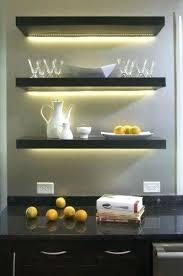 floating shelves with lights use led light bars or led strip lights to create lighting under