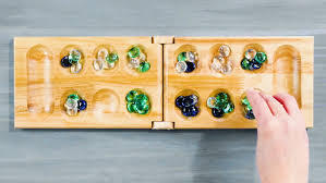 Game With Rocks And Wooden Board New How To Play Mancala