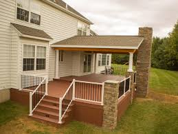 two tier deck with stone fireplace rustic deck