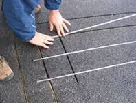 installation of heated driveway systems snow melting systems asphalt driveway retrofitted radiant snow melting cable