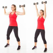 Woman doing shoulder dumbbell presses