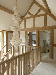 lighting for hallways and landings. border oak with glass balustrade and modern lighting this would look quite for hallways landings