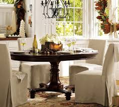 montego expanding round dining table from pottery barn