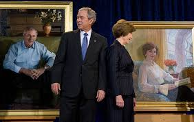 us president george w bush stands beside first lady laura bush during the unveiling of