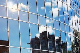 Background Glass Office Building Windows With Reflection Of Sky