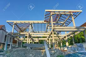 new residential construction home concrete framing against a blue sky stock photo 67781952