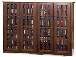 Wooden Storage Cabinets With Doors Dvd Storage Cabinet With Glass Doors Best Home Furniture Decoration