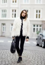 ingrid holm is wearing a white gy jacket from lindex