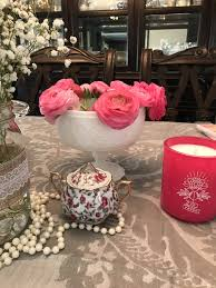 white vintage milk glass and pink ranunculus