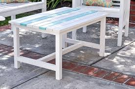 close up white diy outdoor coffee table with aqua stripes
