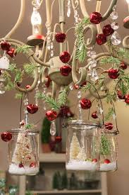 bottle brush trees in hanging glass votives fir branches and red jingle bells