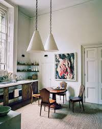 industrial inspired furniture. The Kitchen Features Rustic Furniture, A Bold Artwork And Industrial- Inspired Pendant Lamps, Industrial Furniture N