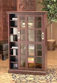 Brown Tall Wooden Bookcase with Sliding Glass Doors On Semi Classic ...