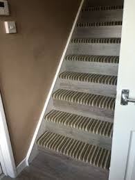 carpet laminate stairs. mixture of carpet and laminate stairs for a nice transition from upstairs to downstairs.