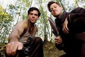 inglourious basterds inglourious basterds wiki fandom powered inglourious basterds behind the scenes eli roth a gun and brad pitt his knife