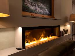 electric fireplace insert with black frame and cream wall for warm room ideas