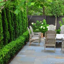 falkner gardens :: walled courtyard garden terrace at Mountain Brook,  Alabama residence featuring low boxwood hedge in front of arborvitae screen