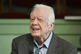 A mask and parade: Jimmy Carter ...