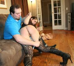 Spanked husband over her knee
