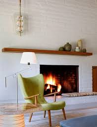 Painted brick with wood mantle Portola Valley - midcentury - Living Room -  San Francisco - The Office of Charles de Lisle