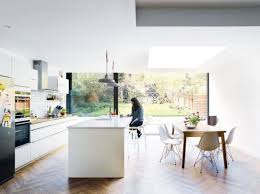 mid century modern kitchen white. Light-filled Kitchen In White With A Large Island And Dinign Area Mid Century Modern