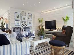striped sofas living room furniture. Nice White Coastal Beach Themed Living Room With Striped Sofa And Area Rug Patterned Blue Club Chairs Decorated Frames On The Wall Sofas Furniture E