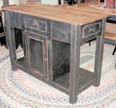 primitive island I want in my kitchen but maybe not in black I think it  would be red for a pop of color