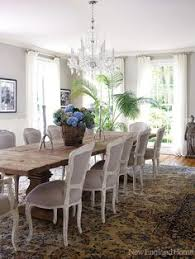 a rustic dining table gets dressed up with nineth century louis xv style chairs