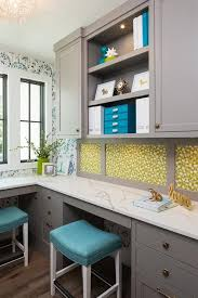 gray office desk. gray blue and green home office space features an l shaped desk with