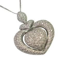a contemporary design large heart shaped pendant set with brilliant cut diamonds weighing 3 5cts
